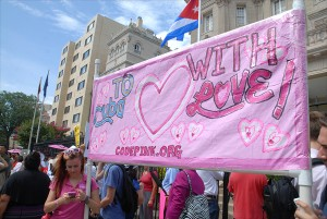 Members of CodePink, a nonprofit group that opposes the U.S. embargo against Cuba, celebrate July 20 in front of the newly inaugurated Cuban Embassy in Washington.