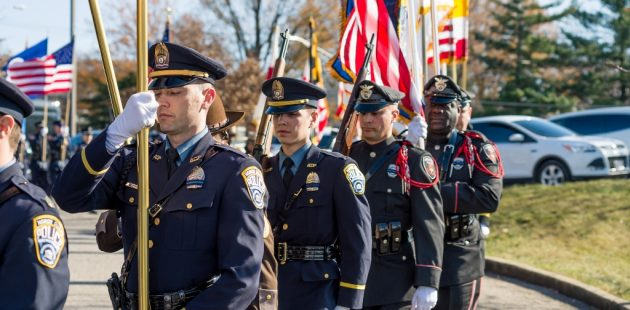 A contingent of visiting police pays tribute to fallen Baltimore City Police Detective Sean Suiter. (Michael Jordan)