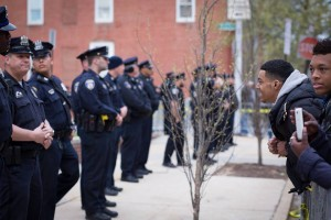 Police hold their ground during the aftermath of the Baltimore Riots. (Erik Hoffman)