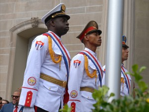 A three-man honor guard prepares to raise the Cuban flag over the country's embassy in Washington for the first time in 54 years.