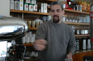 Longtime Georgetown manager Martin Cotignola making a cup of coffee behind the bar