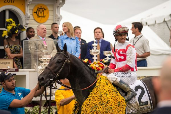 Jockey Javier Castellano atop Cloud Computing in the winners circle at the 2017 Preakness. (Michael Jordan)