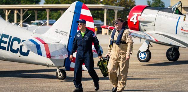 Pilot Mike Brockey and reporter Anthony C. Hayes walk the GEICO Skytypers flight line at Martin State Airport. The Skytypers are in Baltimore for Maryland Fleet Week. (Michael Jordan / BPE)