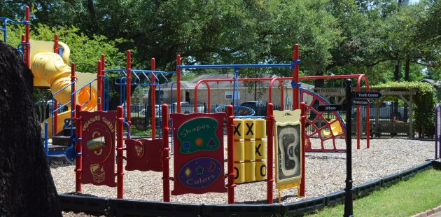 A playground behind the offices of Urban Impact Ministries provides an oasis for children in Central City New Orleans. (Anthony C. Hayes)