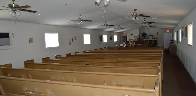 The sanctuary of Disciples of Christ Christian Fellowship Ministry in New Orleans' Lower Ninth Ward. The pews were donated by the congregation of Salem Church on Staten Island. (Anthony C. Hayes)