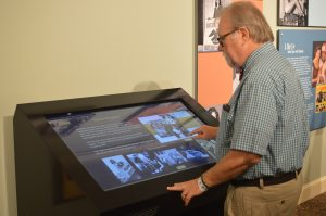Vinny Czepiel tries out the new touchscreen kiosk at the Ava gardner Museum in Smithfield, North Carolina. (Anthony C. Hayes)