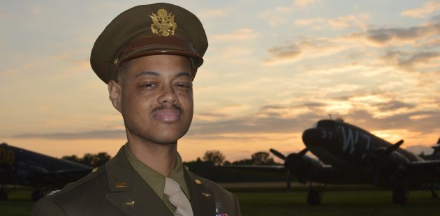 Reenactor/educator Michael Joseph III honoring the Tuskegee Airmen at the National Warplane Museum Airshow. (Anthony C. Hayes)