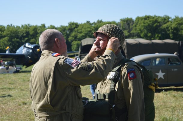 """C-47 Whiskey 7 at the 2019 National Warplane Museum Airshow. Liberty Jump Team jumpmaster """"Tater"""" Taylor performs a final safety inspection of team member Denny Archer. (Anthony C. Hayes)"""