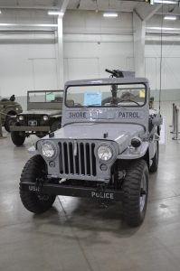 A US Navy Shore Patrol JEEP in Battleship Grey on display at the 2019 Military Vehicle Preservation Association Convention in York, PA. (Anthony C. Hayes)