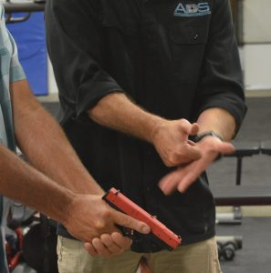 Concealed carry in Maryland: Joe Lynch of Annapolis Defense & Security instructs a student in the proper use of a handgun. (Anthony C. Hayes)