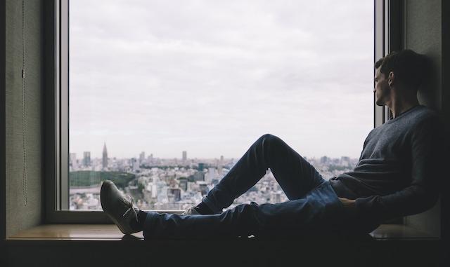 A person sitting alone.