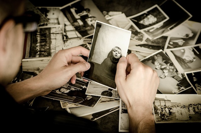 A person looking at old photos.