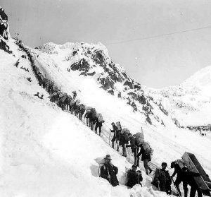 Klondikers carrying supplies ascending the Chilkoot Pass, 1898 (Library Washington University)
