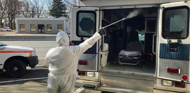 A service technician from Delaware-based National Restoration applies a disinfecting spray fog to the interior of an ambulance. National Restoration has launched a dedicated Coronavirus Disinfection Division. (courtesy)