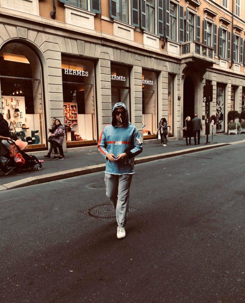 Dimitri during a walk in Via Montenapoleone, Milan