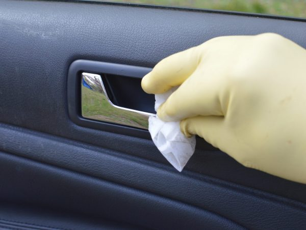 Using disinfecting wipes for cleaning a car of COVID-19 coronavirus