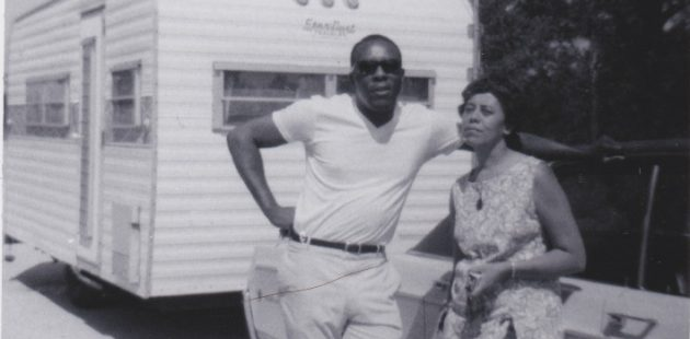 Everyone But Two: Benjamin and Frances Graham in front of their travel trailer