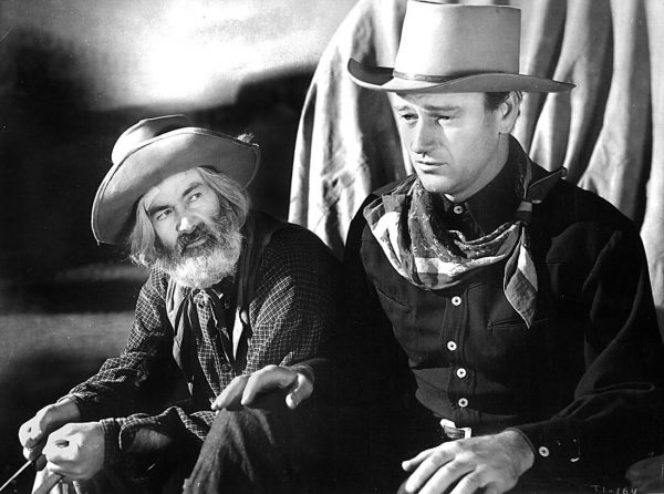 Gabby Hayes with John Wayne in a screenshot from Tall in the Saddle.