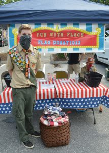 Boy Scout flag burning retirement ceremony: Troop 306 member Jack Callahan manning the flag collection booth at the Catonsville Farmers Market. Anthony C. Hayes)