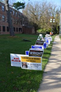 Vote: Campaign signs outside a voting center at Dickey Hill Elementary School in Baltimore City. (Anthony C. Hayes/BPE)
