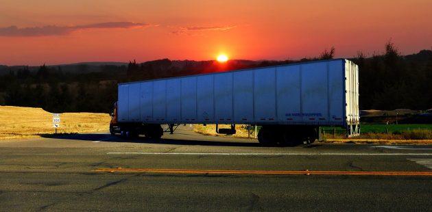 Truck trailer at sunset: credit RENE RAUSCHENBERGER from Pixabay