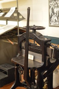 An old-school press in the print shop at the BMI. (credit Anthony C. Hayes)