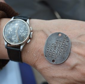 TBM Avenger flight: Lynn Stepanian-Smith shows us the watch and dog tag of her late father, U.S. Navy aviator Edward Stepanian. (credit Anthony C. Hayes/BPE)
