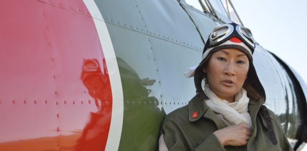 """Zero / Kate pilot: Baltimore Post-Examiner contributing photographer Lady Camille donned the authentic garb of a Japanese pilot to pose beside a replica IJN Nakajima B5N2 """"Kate"""" at the 2021 MAAM WWII Weekend. (credit Anthony C. Hayes)"""