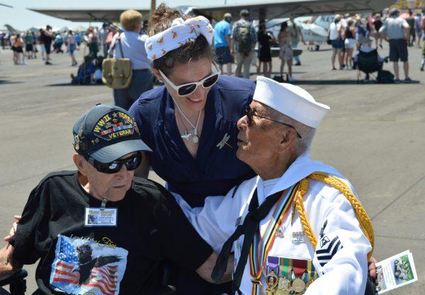 Reenactor Alexandra Pinamonti stops to greet veterans Victor Marulli and Fame Academia. (credit Anthony C. Hayes)
