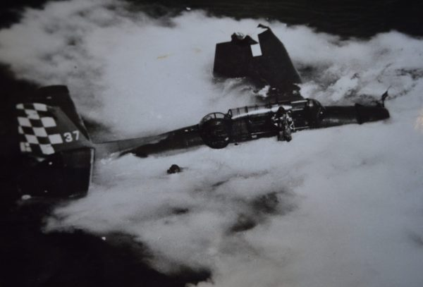 An unknown Navy photographer captured Edward Stepanian (in the water at left) and his pilot (standing on the wing) as they awaited rescue after their overladen TBF Avenger went into the water while trying to take off from the USS Cowpens. It is thought that the rear turret gunner (who also survived the crash) may be in the water or clinging to the wing on the other side of the plane. All three airmen ended up in sickbay after their toxic 30-minute bath of sea water and leaking airplane fuel. Credit: The Edward Stepanian Collection courtesy Lynn Stepanian-Smith.