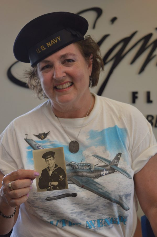 Wearing his sailor cap, Lynn Stepanian-Smith. poses with a picture of her late father Edward Stepanian. (credit Anthony C. Hayes/BPE)