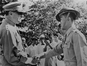 General MacArthur, left, congratulates Captain Villamor (one of the small group of flyers that did heroic service in the Battle) of the Philippine Air Force, after awarding him the Distinguished Service Cross, December 22, 1941. (Library of Congress).