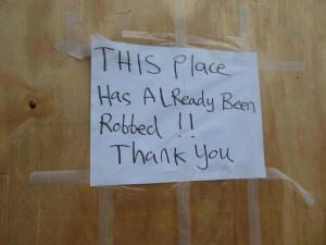 One of the many signs that hang on the doors of businesses that were looted during the riots. (Anthony C. Hayes)