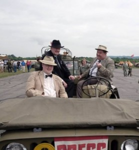 Abbott and Costello (Bill Reily and Joe Zeigler) and Scoop Fields (Jason Crutchley) bum a ride with the press (Lady Camille)