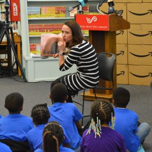 "Heidi Daniel entertained the thoroughly-engaged children with two ""story-time"" readings at the Prattl Library Amazon STEM donation event. (Anthony C. Hayes)"