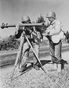 Battle of the Bulge cancellation: American soldiers using a coincidence rangefinder with its distinctive single eyepiece during army maneuvers in the 1940s. (Wikimedia) Vintage army equipent is used in the annual Battle of the Bulge reenactment.