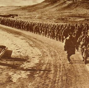 American troops walking along a road during World War I. (Wikimedia)