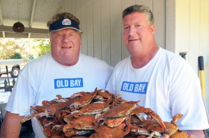 Boog with son J.W. and a tray of steamed blue crabs. (Jim Burger)