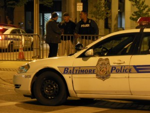 Baltimore City police on night duty at the War Memorial.  (Anthony C. Hayes)