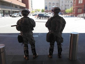 Guardsmen stand at the entrance to Johns Hopkins Hospital. (Anthony C. Hayes)