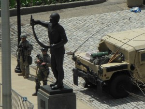National Guardsmen at positions next to the Negro Soldiers statue in front of Baltiome City Hall. (Anthony C. Hayes)