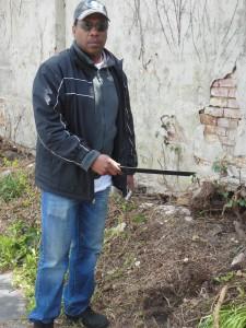 Holding tha machete which was found hidden the brush behind Zion Church. (Anthony C. Hayes)