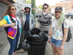 Four of the many local college students who converged on area around the torched the CVS drugstore to help the city clean up the mess. (Anthony C. Hayes)
