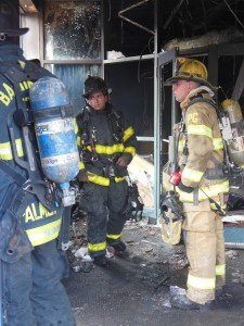Firefighters survey the damage at the CVS Pharmacy on North Avenue. (Anthony C. Hayes)