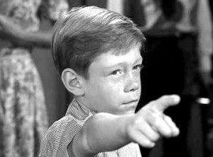 "Billy Mumy wishing someone into the cornfield in a screenshot from the Twilight Zone episode ""It's a Good Life""."