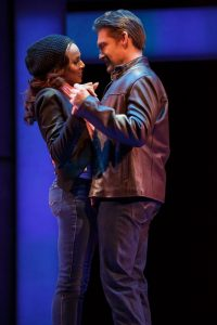 Rachel and Frank (Deborah Cox and Judson Mills) share a tender moment in The Bodyguard: The Musical.
