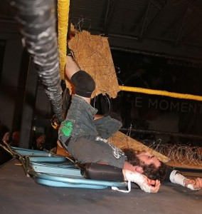 Devon Moore barely survived an Exploder Suplex through a barbed wire board. (Lyle C. Williams)