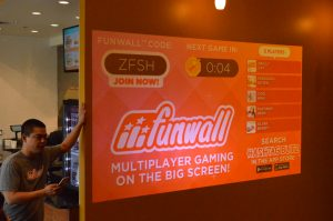 Employee Tony Lomolino talks about the FunWall. (Anthony C. Hayes)