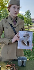 Governors Island Sept 16, 2018: Reenactor Lillian Fehler holding a picture of the historical person she portrays: Dr. Anna Tjomsland. (Camilla Hsiung)