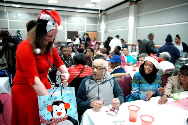 Meg Bowen plays Santa for a group of happy party-goers. (Stacy Atwell)